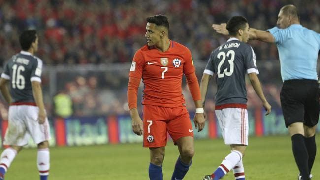 Chile's Alexis Sanchez (C) in action for Chile.