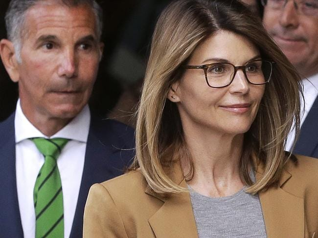 Lori Loughlin, front, and husband, clothing designer Mossimo Giannulli, left, leave federal court in Boston after facing charges in a nationwide college admissions bribery scandal. Picture: AP