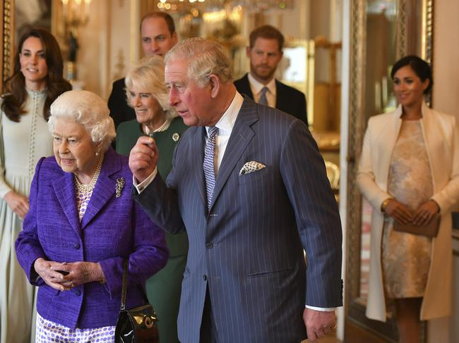 Britain's Queen Elizabeth II wore purple to the event, a colour of which she is fond. Picture: Dominic Lipinski/Pool via AP