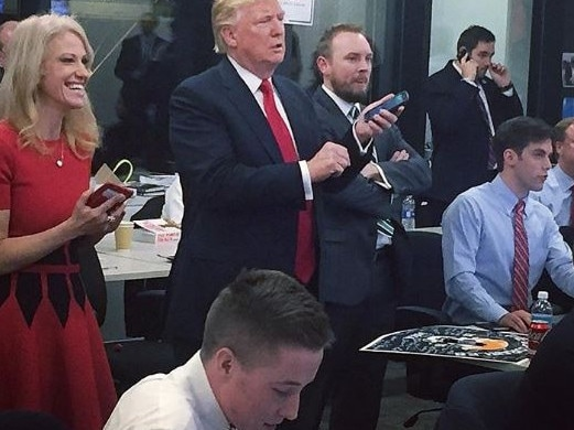 Cliff Sims (arms crossed) with Donald Trump and Kellyanne Conway. Picture: Twitter