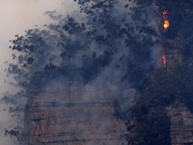 Fire moves along the Narrow Neck plateau from the Ruined Castle Fire in the Blue Mountains National Park. Picture: Image/Jeremy Piper