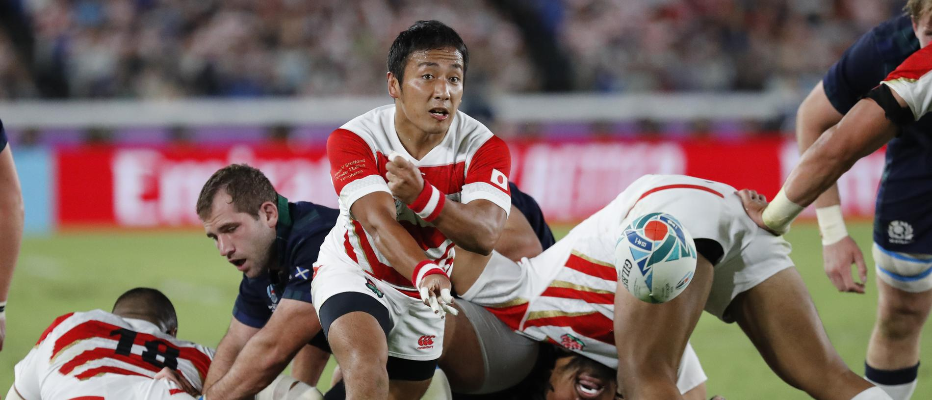 Japan's Yutaka Nagare passes the ball during the Rugby World Cup Pool A game at International Stadium between Japan and Scotland in Yokohama, Japan, Sunday, Oct. 13, 2019. (AP Photo/Eugene Hoshiko)