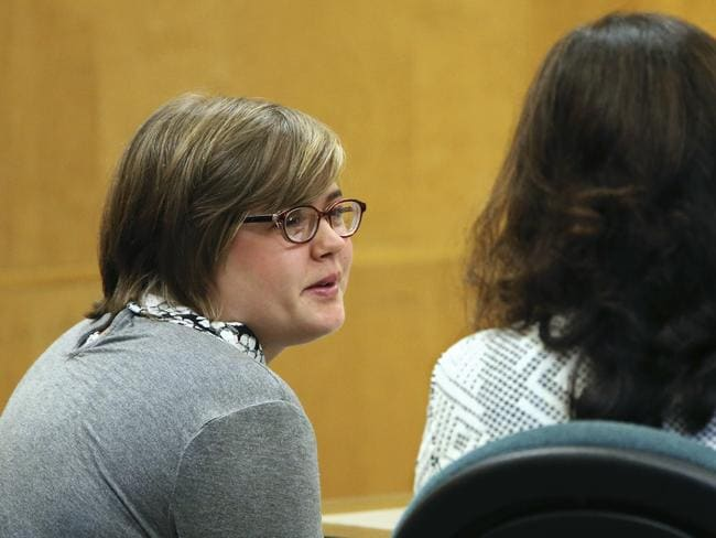 Morgan Geyser, left, one of two Wisconsin girls charged with stabbing a classmate to impress the fictitious horror character Slender Man, sits in a Waukesha County Courtroom. Picture: Michael Sear/AP