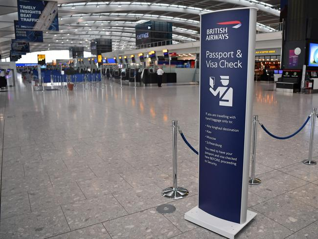 A few passengers walk around the near-deserted departure area at Heathrow airport Terminal 5 as British Airways' first-ever pilots' strike began. Picture: AFP