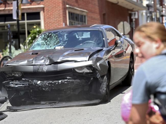 A vehicle reverses after driving into a group of protesters in Charlottesville, Va. Picture: Ryan M. Kelly/The Daily Progress via AP