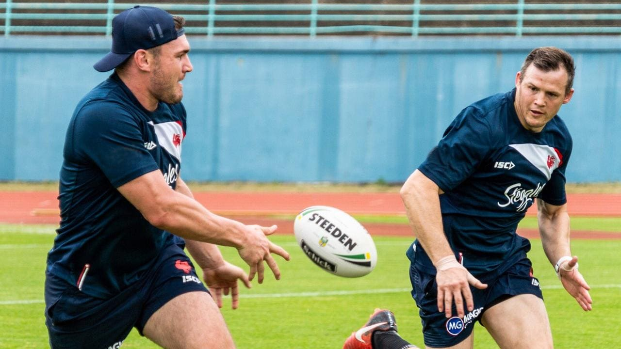 Angus Crichton passes to Brett Morris at Roosters training. Photo: Sydney Roosters.