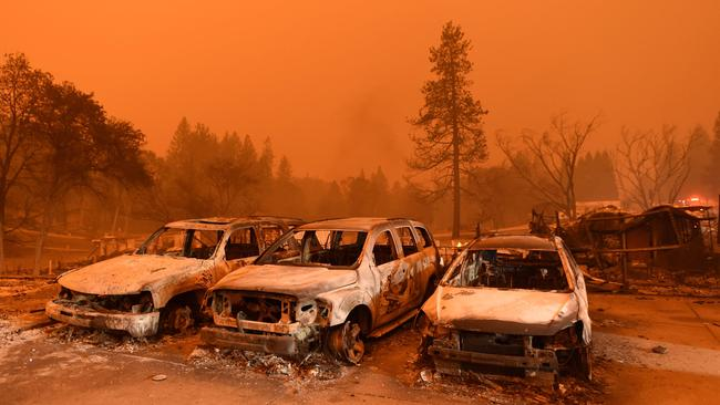 Vehicles lie broken and abandoned after they were ravaged by the flames in northern California.