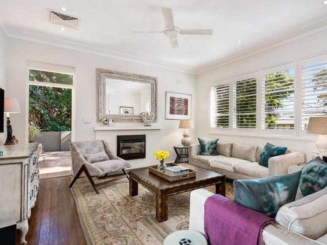 The lounge, with timber floors and plantation shutters, at 37 Edward St, Woollahra.