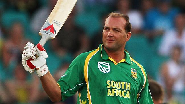 Batsman Jacques Kallis raises his bat after he reached 10,000 one day runs during the Australia v South Africa one day international match at the SCG.
