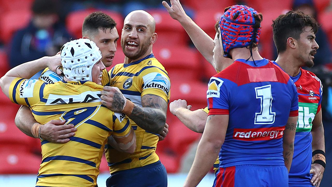 Ryan Matterson of the Eels is congratulated by teammates after scoring a try.