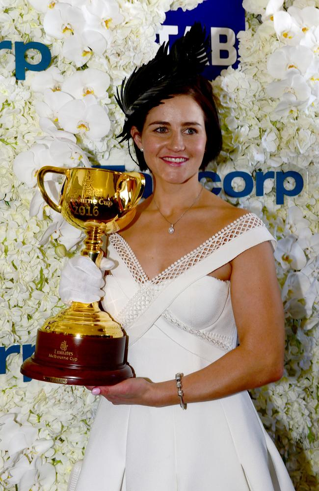 Jockey Michelle Payne poses with the Melbourne Cup.