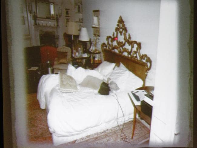 A slide of the bed where Michael Jackson died is shown during the prosecution's opening arguments in the Conrad Murray involuntary manslaughter trial.