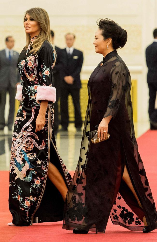0ea3db044 Gucci-clad Melania Trump with Peng Liyuan, wife of China's President Xi  Jinping,