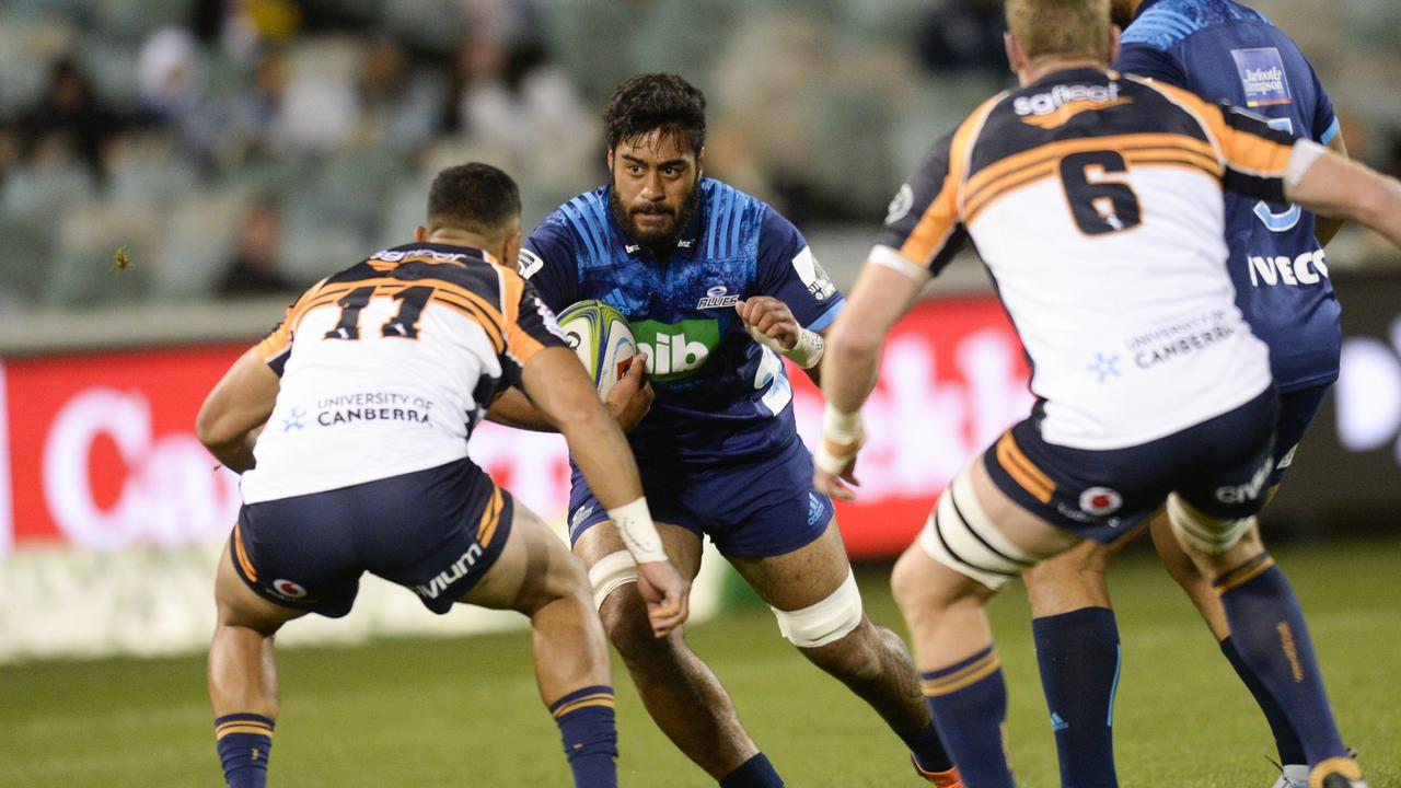 Akira Ioane of the Blues prepares for a hit against Toni Pulu of the Brumbies