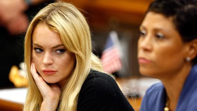 Lindsay Lohan in court in 2010 after being charged with violating her probation when her alcohol detection device went off at a MTV Movie Awards after-party. Picture: AP
