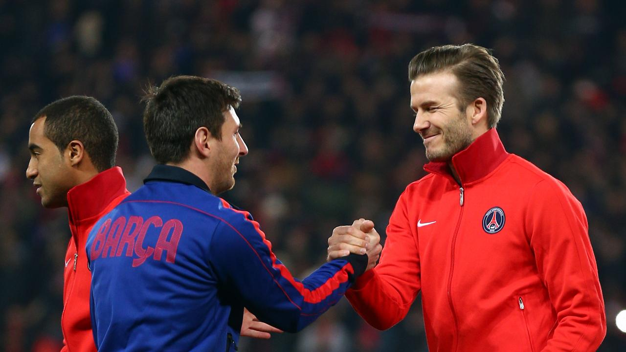 Beckham and Messi shake hands before a Champions League quarter-final tie between PSG and Barcelona in 2013.