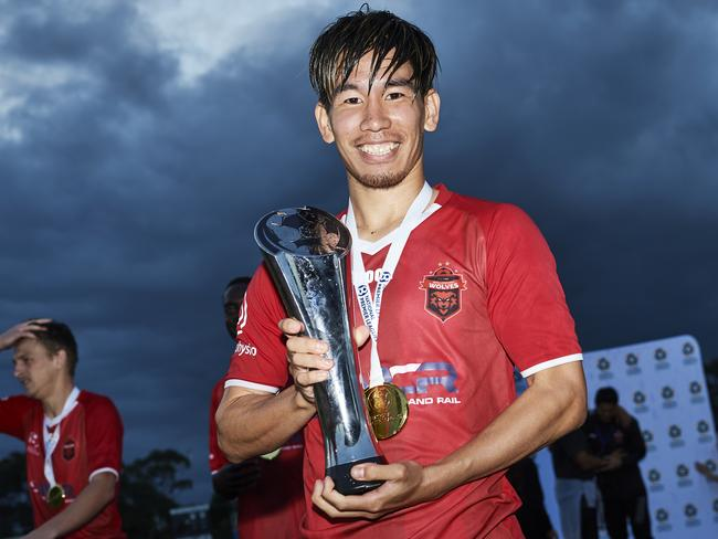 Wolves' Takeru Okada with the trophy after victory in last year's NRL grand final.