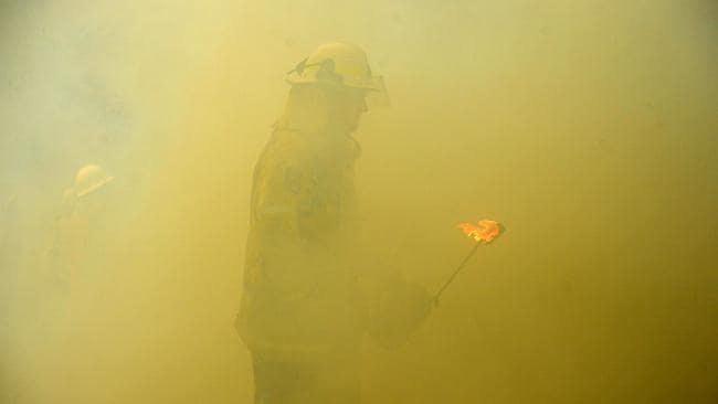 NSW RFS firefighters backburn in Mangrove Mountain, NSW on Sunday. Picture: Jeremy Piper/AAP