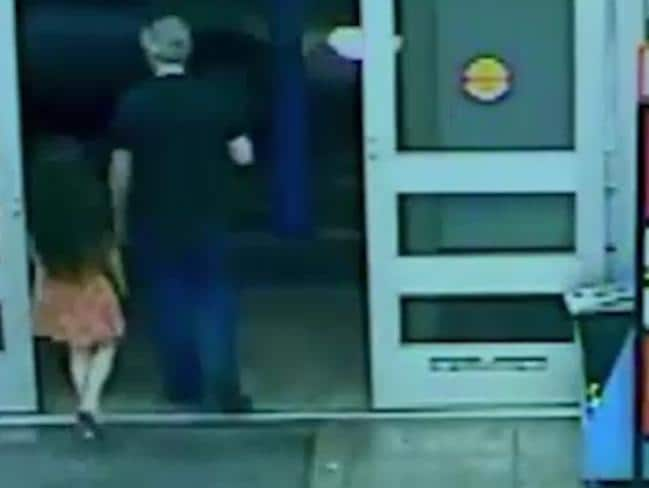 The little girl is led out of the Walmart and to her death. Picture: Screengrab/CBS 47 FOX 30 News