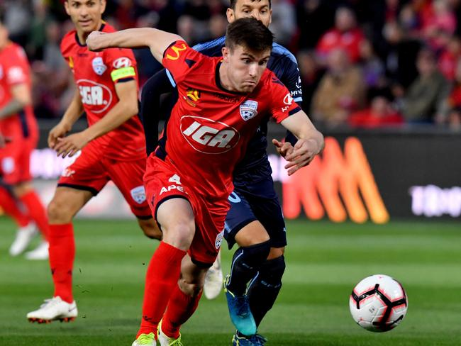 Adelaide United's Ryan Strain in action against Sydney FC. Picture: AAP