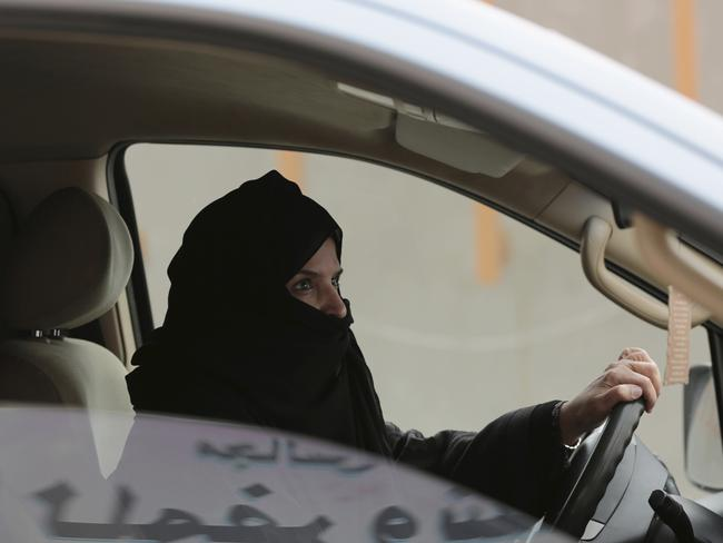 Aziza al-Yousef drives a car on a highway in Riyadh in 2014 as part of a campaign to defy Saudi Arabia's ban on women driving. Picture: AP