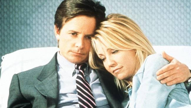Locklear with actor Michael J Fox in scene from Spin City. Picture: Supplied
