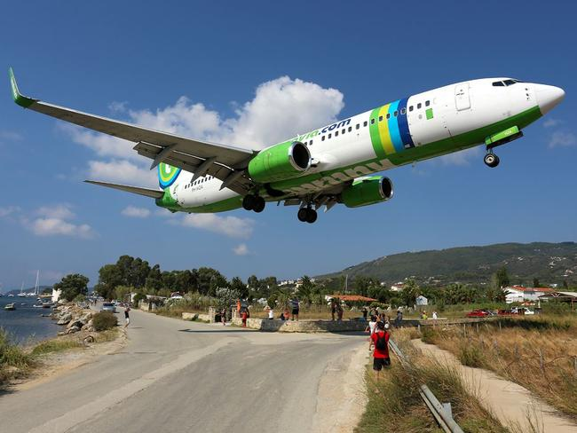 This file image shows a passenger jet flying low to the ground over the Greek island of Skiathos, where the boy was injured. Picture: Wikimedia Commons/Timo Breidenstein
