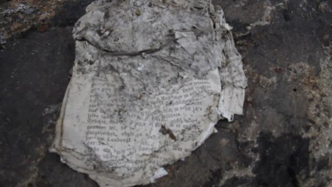 Remarkably well-preserved documents were also found at the site. Picture: Ruptly