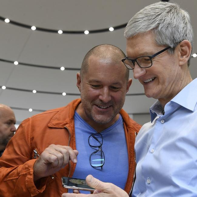 Apple's former chief designer Jony Ive shows CEO Tim Cook the iPhone X.