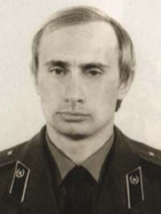 Vladimir Putin in his KGB uniform in the early 1990s.