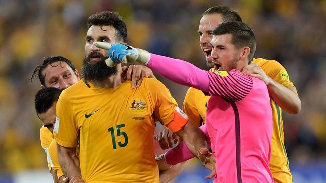 Mile Jedinak of Australia celebrates scoring a goal.