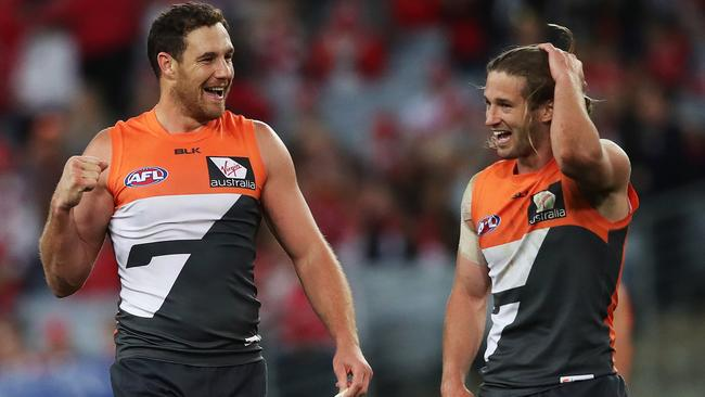 Shane Mumford celebrates with captain Callan Ward after beating Sydney. Picture: Phil Hillyard