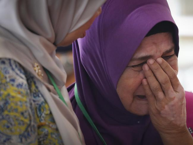 Sarah Nor, the mother of Norliakmar Hamid, a passenger on missing Malaysia Airlines flight MH370, cries after she attended a briefing on the final investigation report. Picture: AP