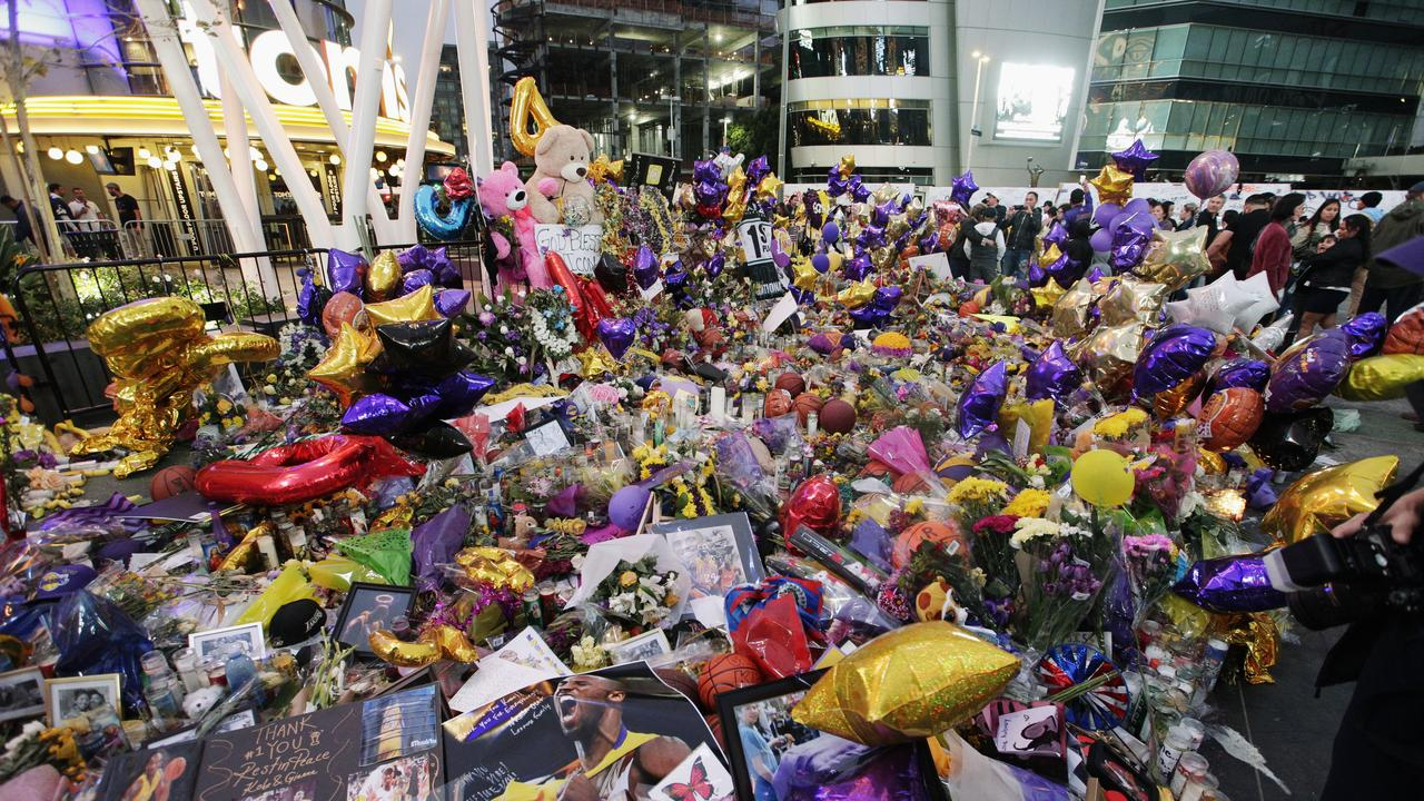 Fans gather at a memorial for the late Kobe Bryant in front of Staples Center. (AP Photo/Damian Dovarganes)
