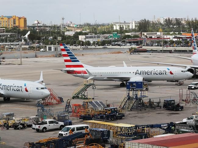 Two grounded American Airlines Boeing 737 MAX 8 are parked at Miami International Airport after the aircraft is suspended. Picture: Joe Raedle/Getty Images/AFP