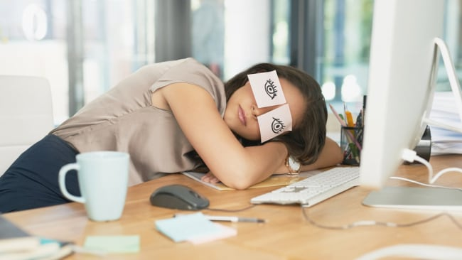 Catching up on sleep at work. Image: iStock.