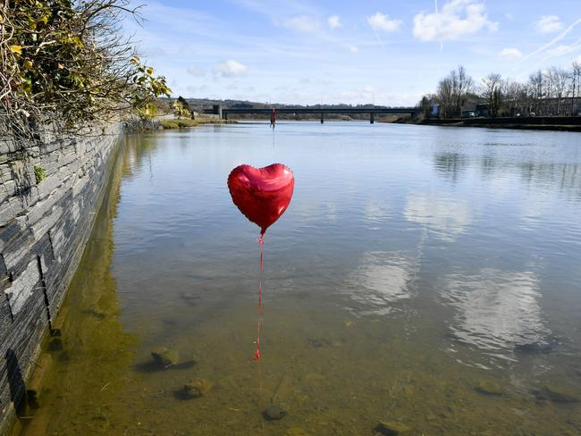 A red balloon in the River Teifi in Cardigan, Wales, near the scene where two-year-old Kiara Moore was recovered from a car that had plunged into the river. Picture: PA Wire