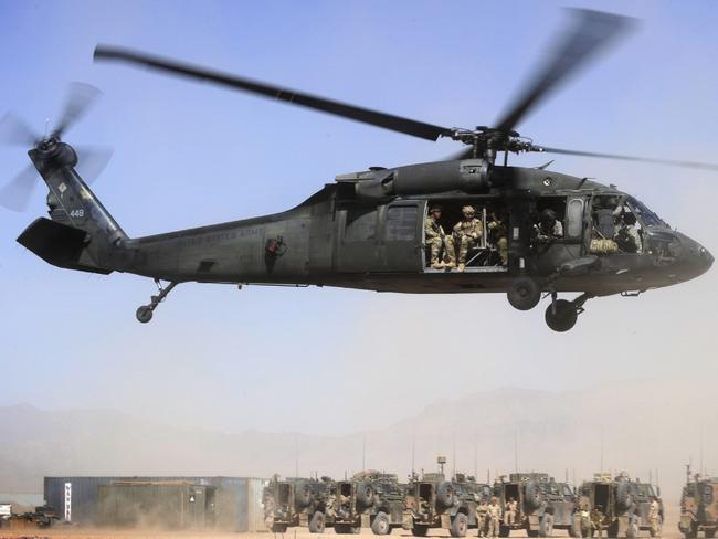 Afghan Officers from the Provincial Police Response Company and Australian Special Operations Task Group Soldiers lift off in a UH-60 Blackhawk helicopter. Picture: Corporal Raymond Vance