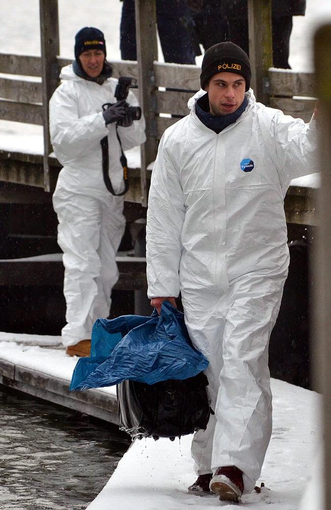Austrian police carry a bag that was retrieved by police divers from the Traunsee in Austria. Picture: EPA/Thomas Leitner/AAP