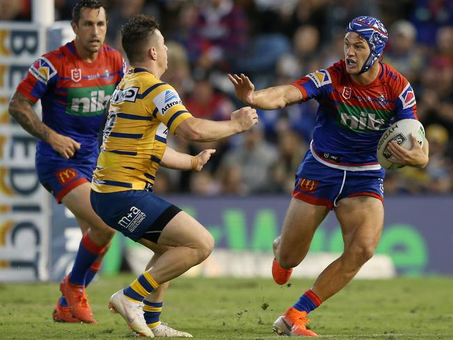 Kalyn Ponga of the Newcastle Knights breaks through the defence during the round 7 NRL match between the Newcastle Knights and Parramatta Eels. Picture: Ashley Feder/Getty Images