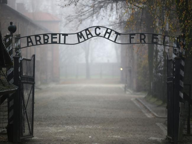 The infamous German inscription that reads 'Work Makes Free' at the main gate of the former Auschwitz I extermination camp on November 15, 2014 in Oswiecim, Poland. Picture: Christopher Furlong