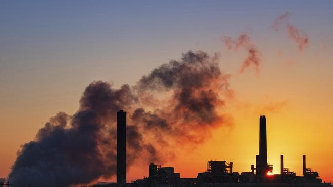 A coal-fired power plant is silhouetted against the morning sun. picture: AP/J. David Ake, File