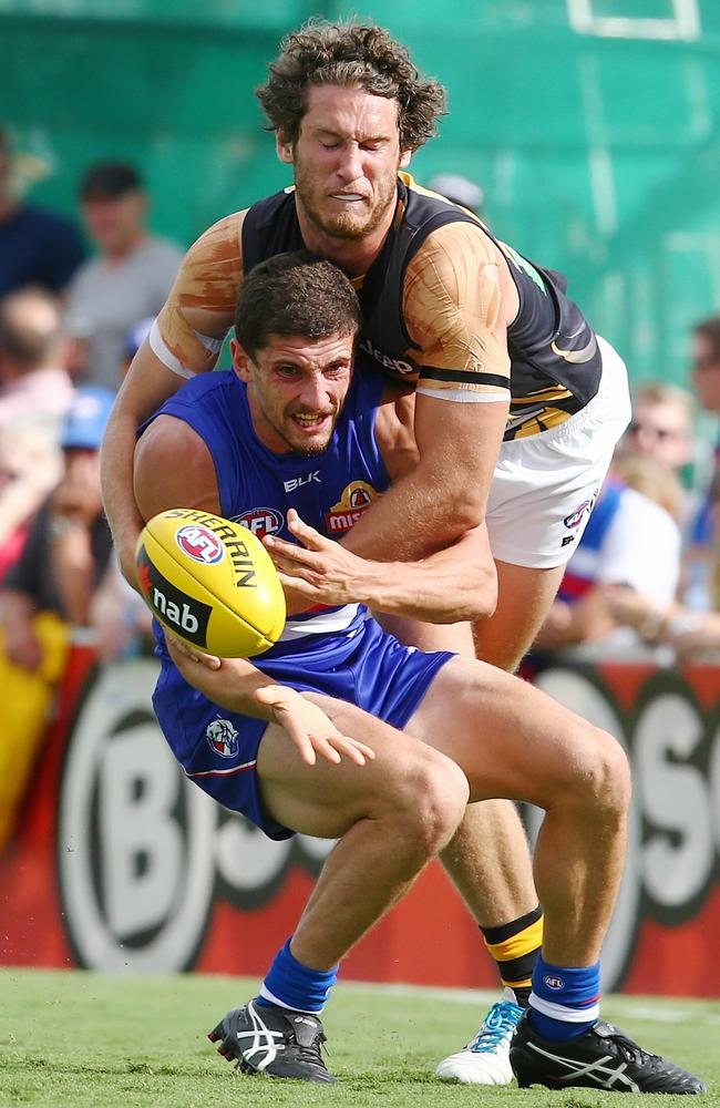 Tom Liberatore tackled by Tyrone Vickery. Picture: Michael Klein