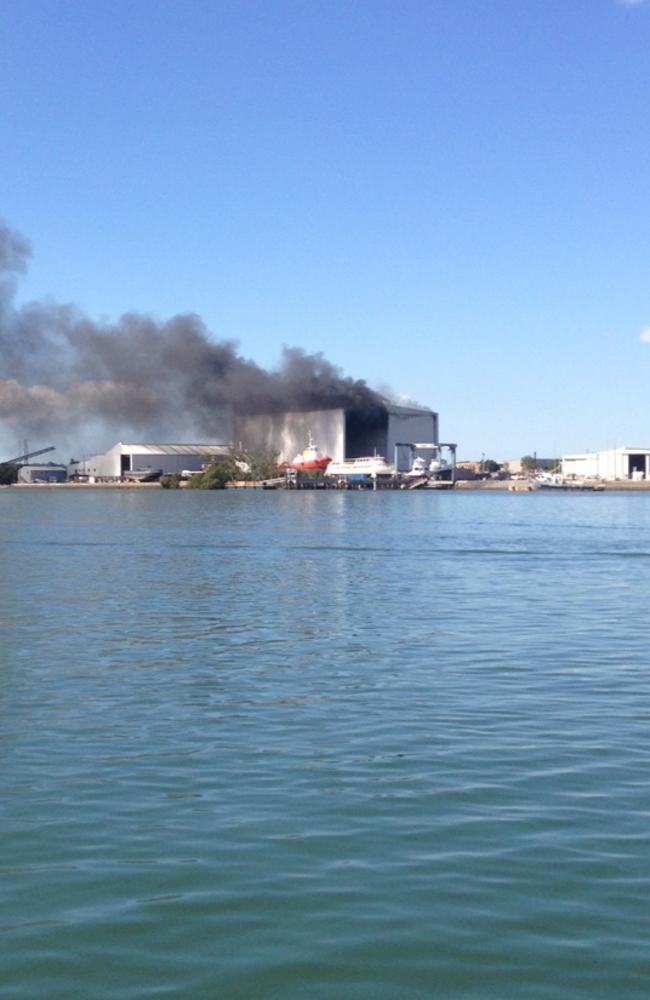 View of the shipyard blaze from across the Brisbane River.