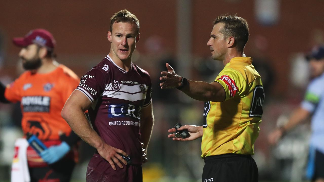 Manly's Daly Cherry-Evans with referee Grant Atkins.