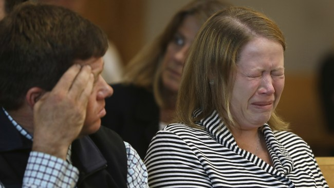 Roy family members react to crime scene photos in court. Photo: Pat Greenhouse / The Boston Globe