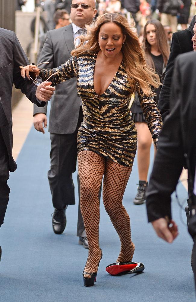 Mariah Carey falls over in high heels on the red carpet