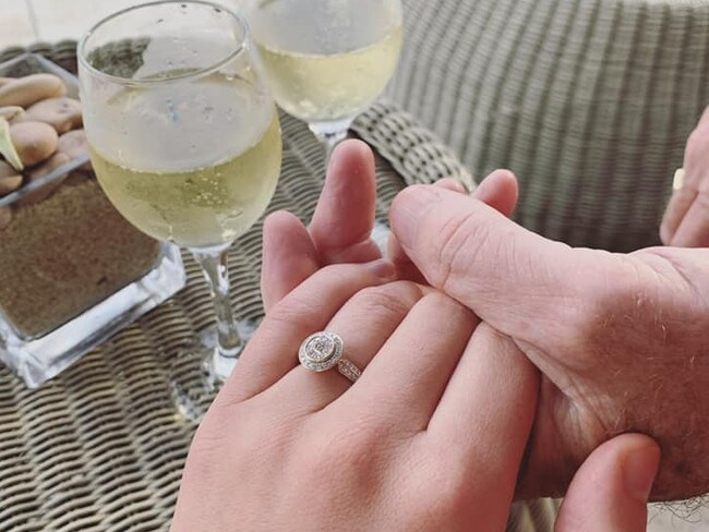 They celebrated their engagement with sparkling wine. Picture: Facebook / Ashleigh Petrie