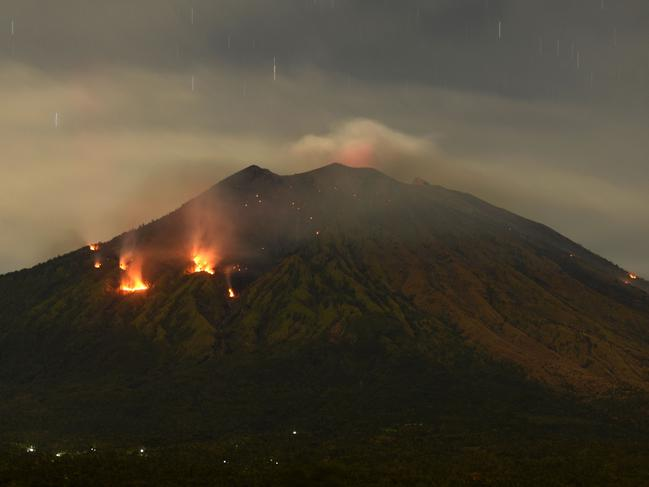 Trees burn on the slopes of Mount Agung volcano after it erupted in June. Picture: AFP