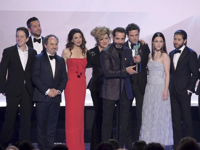 Tony Shalhoub, center, and the cast and crew of The Marvelous Mrs. Maisel, accept the award for outstanding performance by an ensemble in a comedy series at the 25th annual Screen Actors Guild Awards. Picture: AP